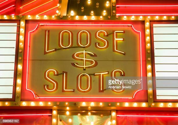 loose slots neon sign at fremont street experience - fremont street experience stock pictures, royalty-free photos & images