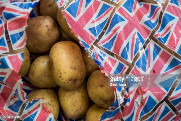 Loose white potatoes sit inside a bag decorated with Union flags also known as Union Jacks inside a Morrisons supermarket operated by Wm Morrison...