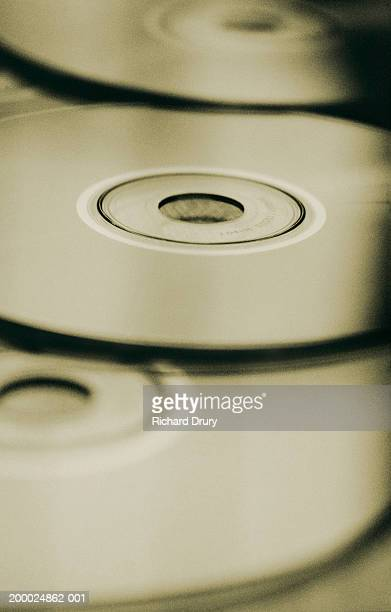 Loosely piled compact discs, close-up