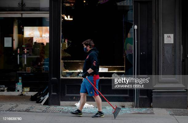 USA: U.S. Cities Clean Up Damage As Riots Continue Across The Country