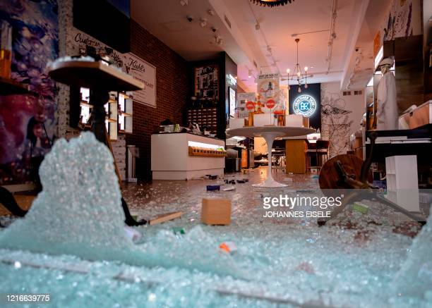 TOPSHOT A looted and destroyed shop is seen after a night of protest over the death of AfricanAmerican man George Floyd in Minneapolis on June 1 2020...