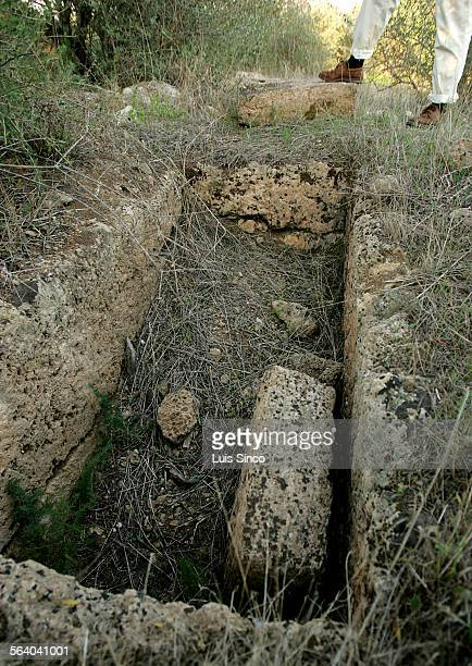 A looted grave lies empty in a sandstone quarry near Castelvetrano Sicily where remnants of ancient Greek settlements dot the landscape The graves...