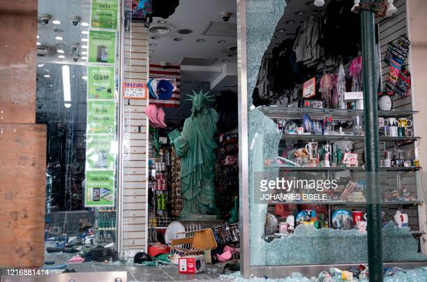 TOPSHOT A looted souvenir shop is seen after a night of protest over the death of an AfricanAmerican man George Floyd in Minneapolis on June 2 2020...
