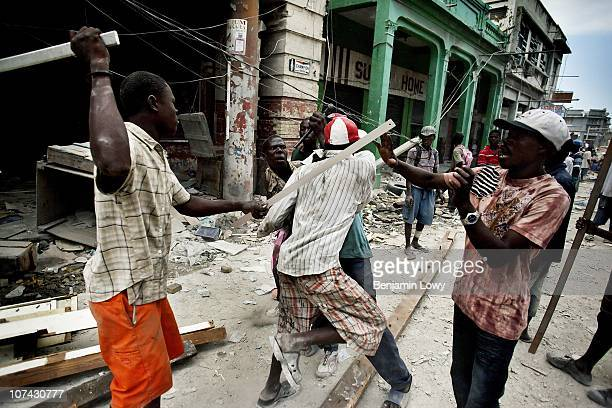 Looters and scavengers fight over debris in earthquake ravaged downtown Port au Prince on February 8, 2010. Scavengers tend to pick through the...