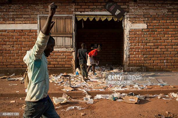 Looters are pictured in Bangui on December 10 2013 Most armed groups have left the streets of the Central African Republic's capital the French army...