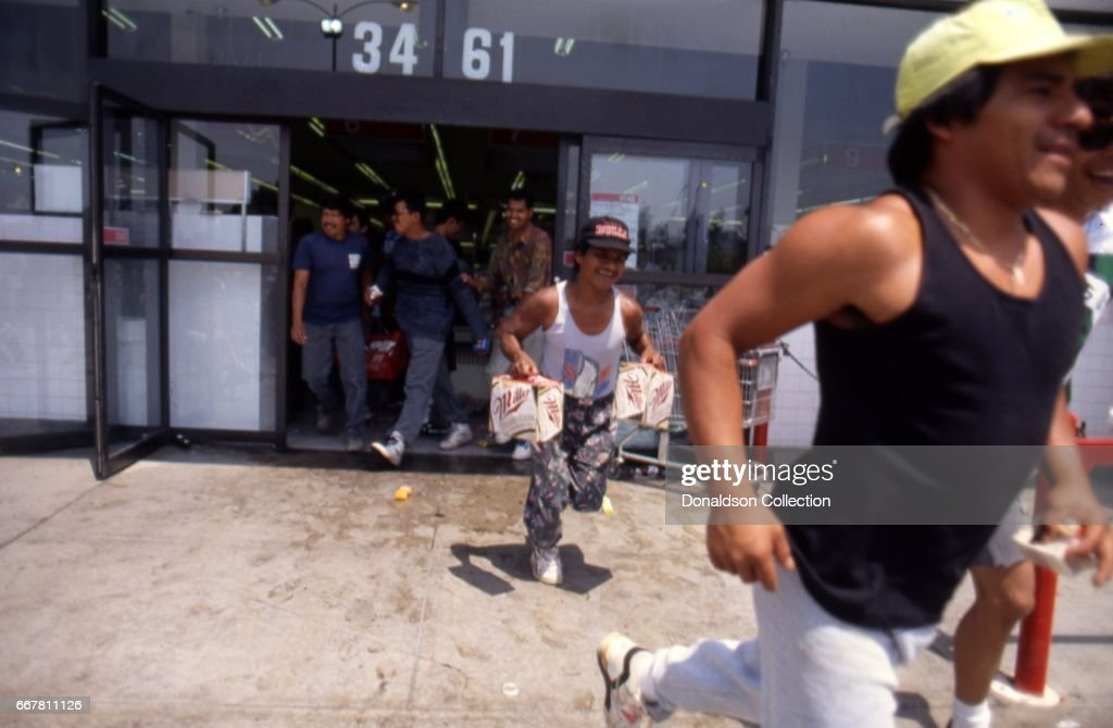 Looters at the Vons grocery store at 3461 W. 3rd Street during widespread riots that erupted after the acquittal of 4 LAPD officers in the videotaped arrest and beating of Rodney King on April 29, 1992 in Los Angeles, California.