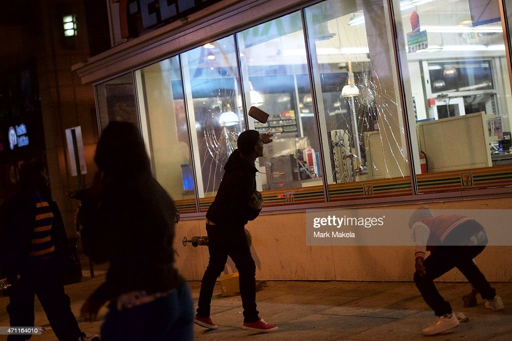 Looters break the windows of a 7-11 and then loot the store April 25, 2015 in Baltimore, Maryland. Freddie Gray, 25, was arrested for possessing a switch blade knife April 12 outside the Gilmor Houses housing project on Baltimore's west side. According to his attorney, Gray died a week later in the hospital from a severe spinal cord injury he received while in police custody.