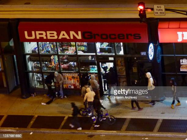 Looters enter a store during protests against the death of George Floyd in the South Loop of Chicago Illinois May 31 2020