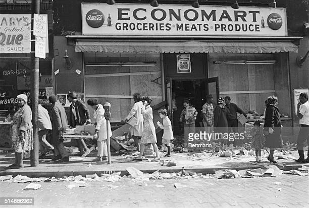 Looters in Pittsburgh cart off merchandise from a market 4/7 marked the third day of sporadic disturbances in the city The disturbances caused...