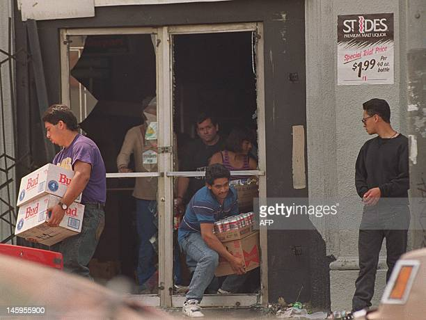 Looters leave a liquor store with cases of beer 01 May 1992 in Los Angeles The 1992 Los Angeles riots with looting and arson events erupted 29 April...