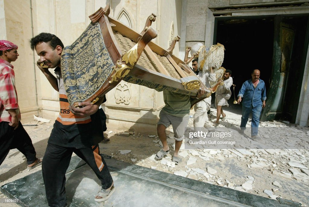 Looters make off with furniture from a Palace April 11, 2003 Baghdad, Iraq. Baghdad, the Iraqi capital is still reeling from widespread looting and fighting.