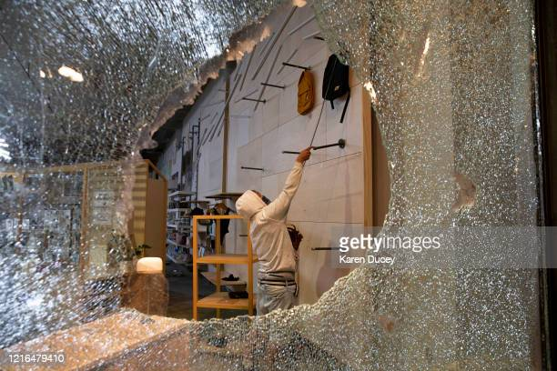 Looters ransack an Urban Outfitters store following a peaceful rally expressing outrage over the death of George Floyd on May 30 2020 in Seattle...
