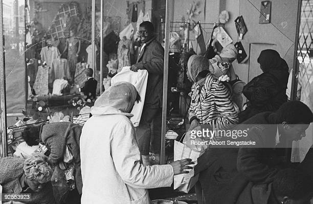 Looters steal from a clothing store during the West Side Riots Chicago Illinois early April 1968 The riots which began in the aftermath of the...