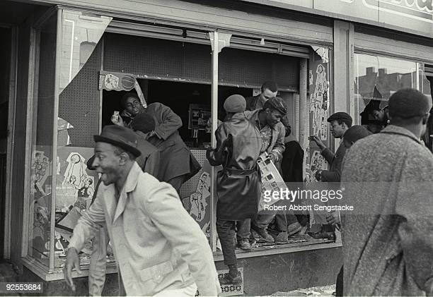 Looters steal from a drugstore near the intersection of West Madison Avenue and Oakley Boulevard during the West Side Riots Chicago Illinois early...