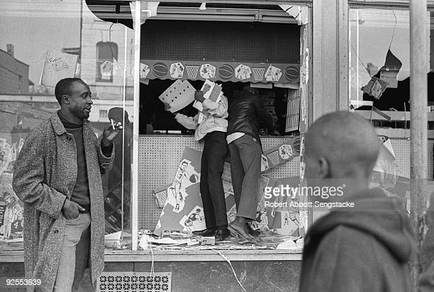 Looters steal from a store during the West Side Riots Chicago Illinois early April 1968 The riots which began in the aftermath of the assassination...