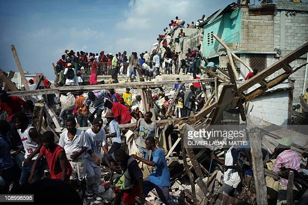 Looters take everything they can in the rubble of a house January 20 2010 in PortauPrince More than a week after the 70magnitude earthquake flattened...