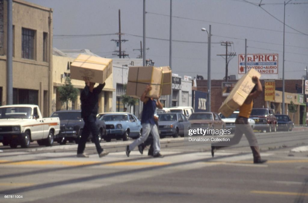 Looters take TV's across the street in widespread riots that erupted after the acquittal of 4 LAPD officers in the videotaped arrest and beating of Rodney King on April 29, 1992 in Los Angeles, California.