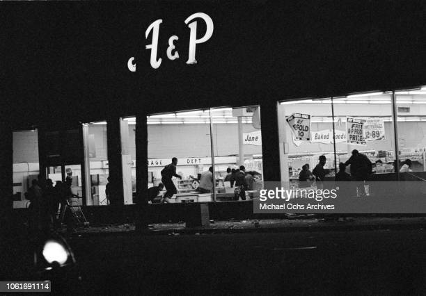 Looting in an AP store during riots in Washington DC following the assassination of civil rights activist Martin Luther King Jr April 1968