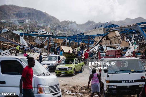 Looting is seen amid destruction September 22 2017 in Canefield in the Caribbean island of Dominica four days after the passage of Hurricane Maria...