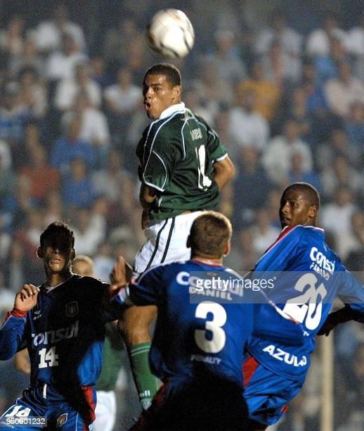 Lopes of the team Palmeiras fights for the ball with Serginho da Silva Daniel and Fabinho of Sao Caetano during a match of the Copa Libertadores de...