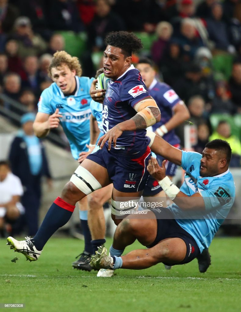 Lopeti Timani of the Rebels is tackled during the round 17 Super Rugby match between the Rebels and the Waratahs at AAMI Park on June 29, 2018 in Melbourne, Australia.