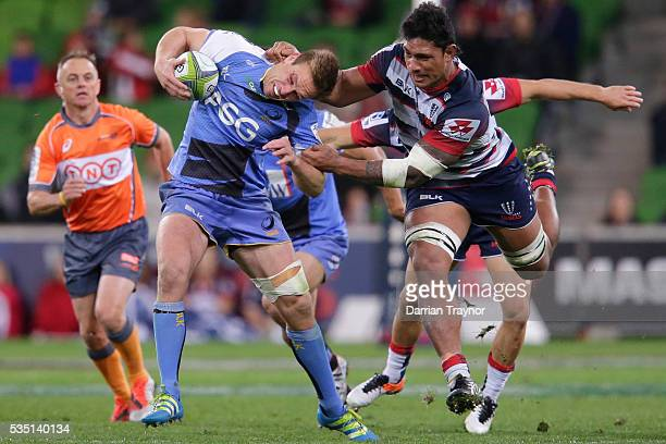 Lopeti Timani of the Rebels tackles Dane HaylettPetty of the Force during the round 14 Super Rugby match between the Rebels and the Force at AAMI...