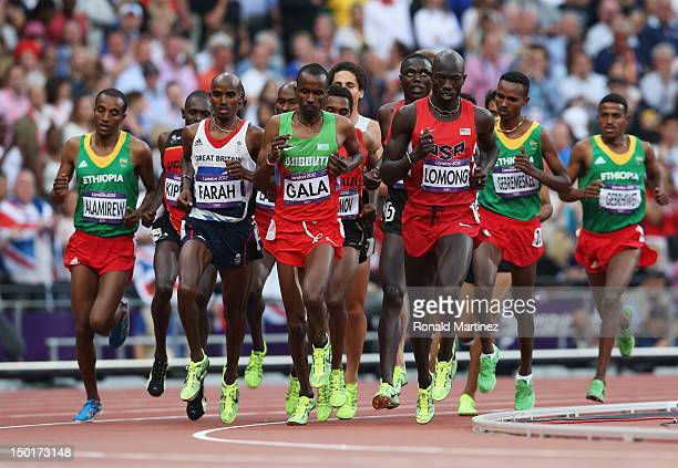 Lopez Lomong of the United States Mumin Gala of Djibouti and Mohamed Farah of Great Britain compete in the Men's 5000m Final on Day 15 of the London...