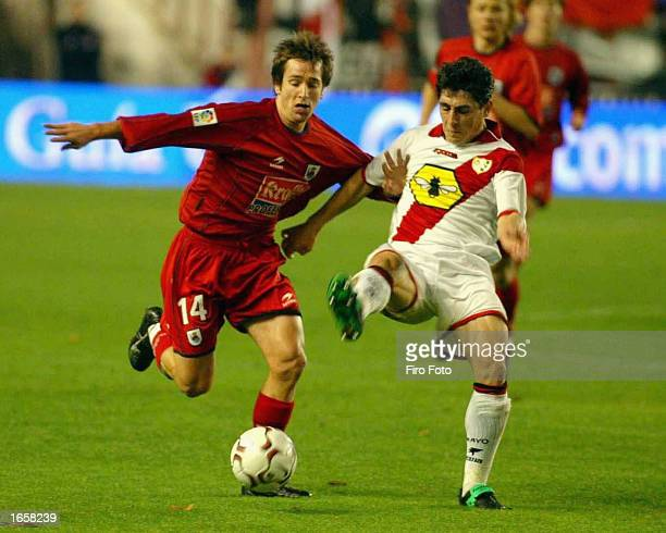 Lopez Rekarte of Sociedad is challenged by Roberto Peragon of Rayo Vallecano during the La Liga match between Rayo Vallecano and Reak Sociedad played...