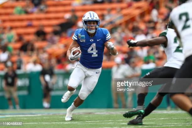 Lopini Katoa of the BYU Cougars runs the ball during the second quarter against the Hawaii Rainbow Warriors of the Hawai'i Bowl at Aloha Stadium on...