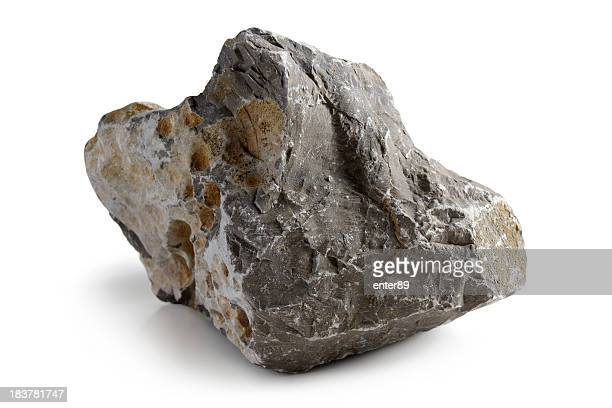 lopsided grey stone with rough edges - rock stock pictures, royalty-free photos & images