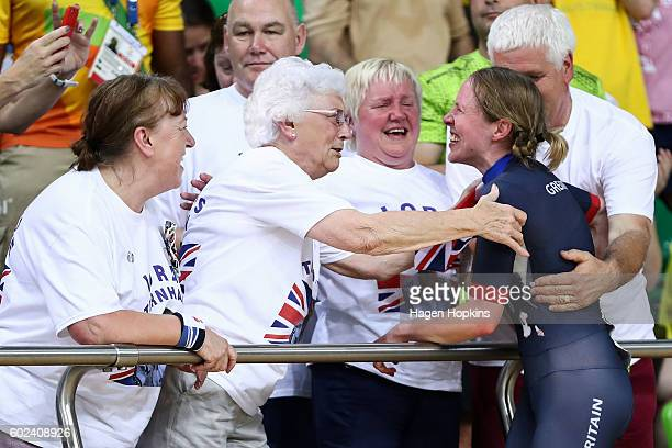 Lora Turnham of Great Britain celebrates with family and friends after winning the Women's B 3000m Individual Pursuit Final on day 4 of the Rio 2016...