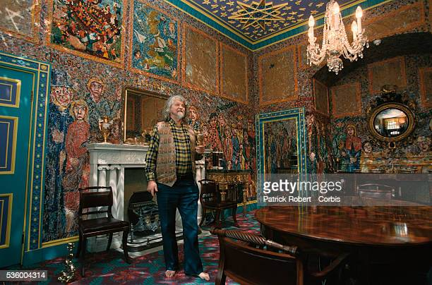 Lord Alexander Thynn 7th Marquess of Bath stands in a colorful dining room at Longleat House Lord Thynn himself painted the inside of the Elizabethan...