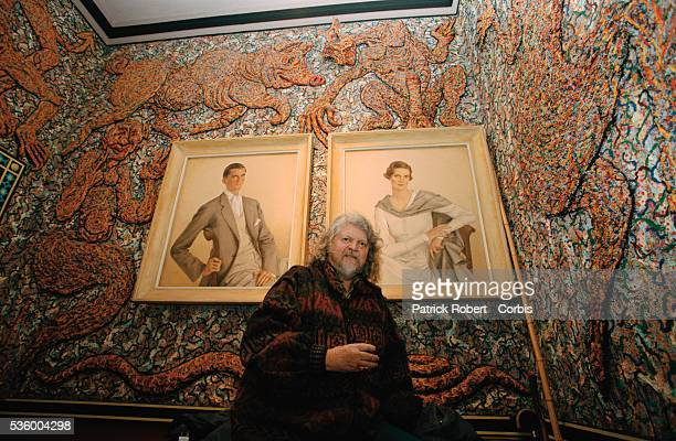 Lord Alexander Thynn 7th Marquess of Bath stands next to two portraits in a room he has decorated with a mural at Longleat House Lord Thynn himself...