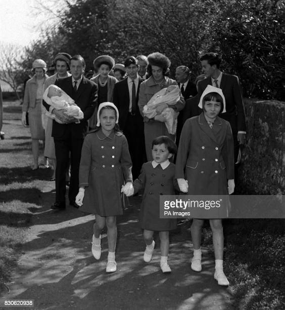Lord and Lady Brabourne are shown carrying their 5 month old twin sons followed by Prince Charles when he was godfather at their christening at the...