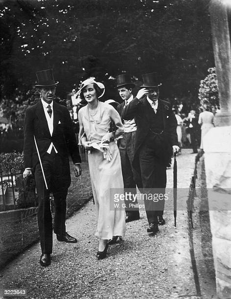 Lord and Lady Cranbourne at the wedding of Phyllis Astor and Lord Willoughby de Eresby at Taplow parish church in Buckinghamshire 27th July 1933