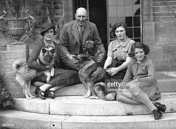 Lord and Lady Digby and their two daughters Pamela and Jaquetta with their pet dogs at their home in Minterne Dorset