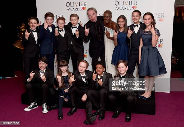 Lord Andrew Lloyd Webber and Laura Mvula pose with cast members from 'School of Rock The Musical' in the winners room at The Olivier Awards 2017 at...