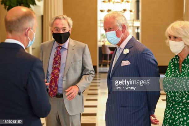 Lord Andrew Lloyd Webber, Prince Charles, Prince of Wales and Camilla, Duchess of Cornwall during a visit to Theatre Royal on June 23, 2021 in...