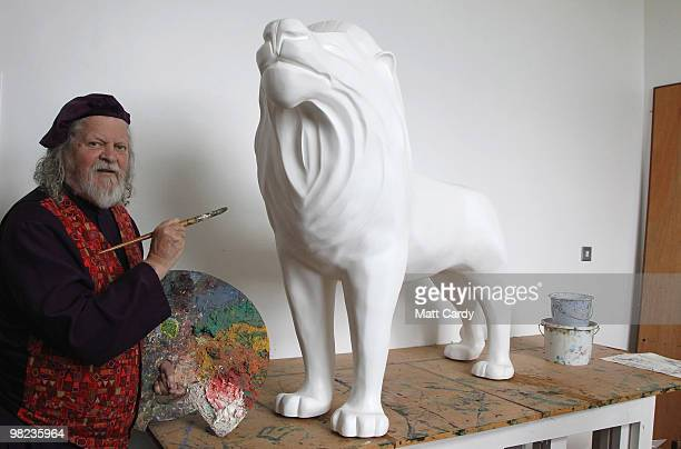 Lord Bath begins to paint a lion given to him by the Lions of Bath public art project to decorate in his studio at Longleat House on April 1 2010...