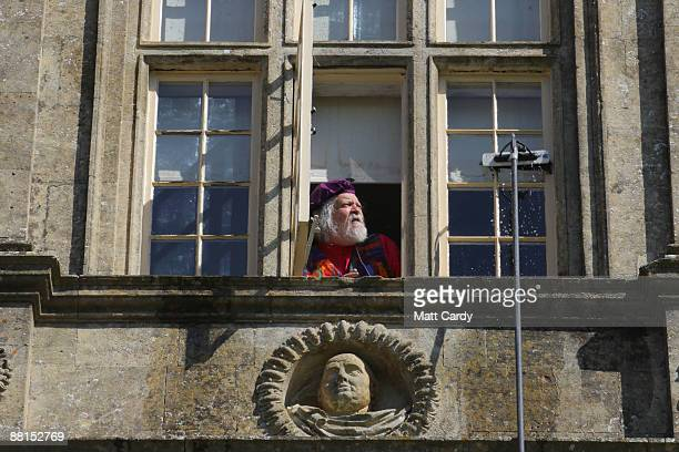 Lord Bath watches from a window of his house as professional window cleaners Nick Walker and Daniel Barr clean the windows at the front of Longleat...