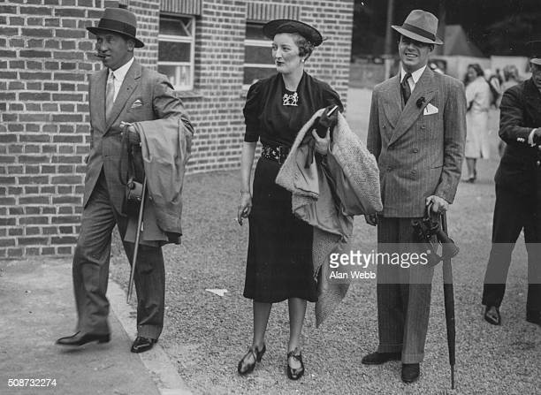 Lord Carnarvon and Prince Aly Khan with a female friend attending Goodwood Races England July 28th 1937