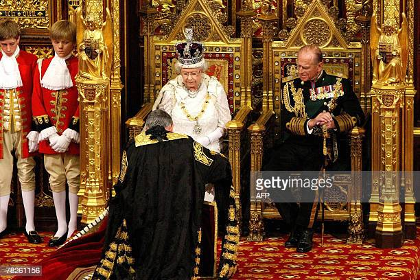 Lord Chancellor Jack Straw kneels before Britain's Queen Elizabeth II whilst the Duke of Edinburgh watches during the State Opening of Parliament at...