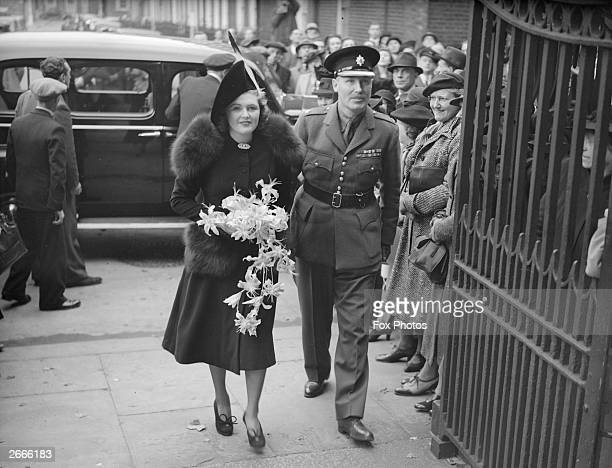Lord Digby escorts his daughter, Pamela to St John's Church, Westminster, London, for her wedding to Randolph Churchill, the Conservative politician...