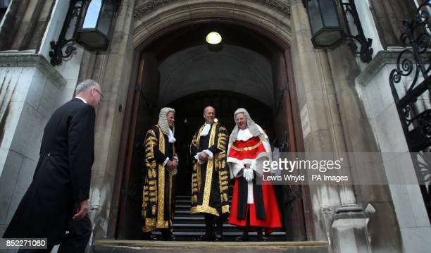 Lord Dyson Lord Chancellor Chris Grayling and the new Lord Chief Justice of England and Wales Sir John Thomas at the Royal Courts of Justice where he...