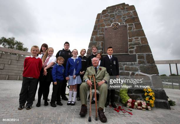 Lord Elgin a direct descendant of Robert the Bruce is joined by local children as he sits beside the Borestone Cairn in the Rotunda after a wreath is...