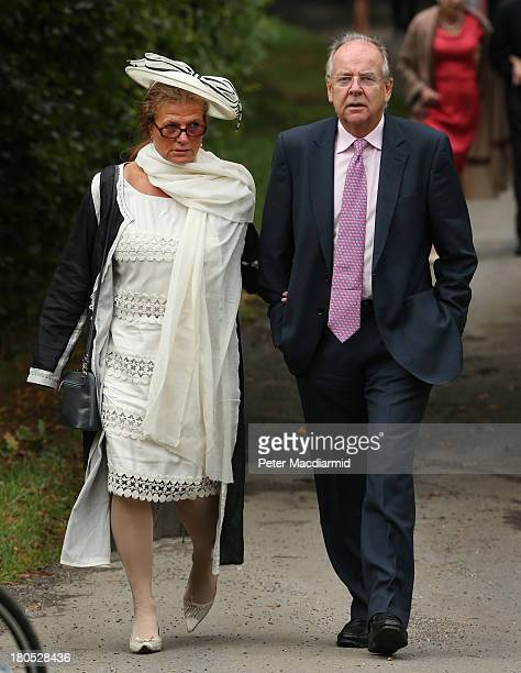 Lord Falconer and his wife Marianna walk to All Saints Parish Church for the wedding of Euan Blair and Suzanne Ashman on September 14 2013 in Wotton...