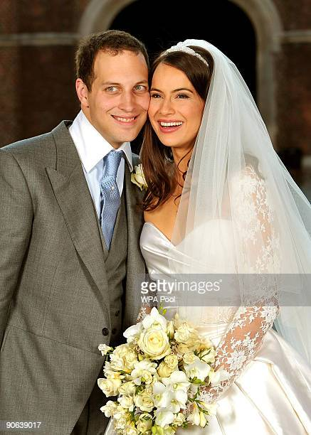 Lord Freddie Windsor poses with his bride Sophie Winkleman in the Base Court, minutes after their wedding in the Chapel Royal at Hampton Court Palace...