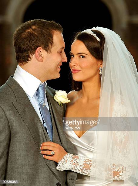 Lord Freddie Windsor poses with his bride Sophie Winkleman in the Base Court minutes after their wedding in the Chapel Royal at Hampton Court Palace...