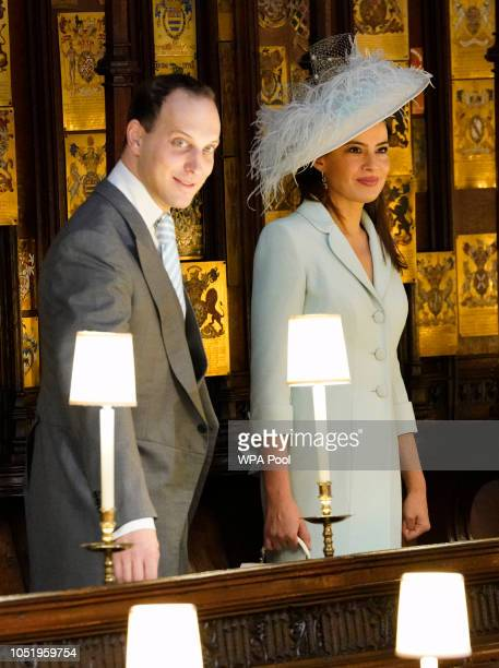 Lord Frederick Windsor and his wife Sophie Winkleman take their seats ahead of the wedding of Princess Eugenie to Jack Brooksbank at St George's...