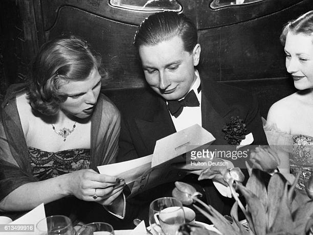 Lord Furness at his comingofage party with Miss Caroline Cust and Mrs Gerald Legge at Maxim's Paris 1950